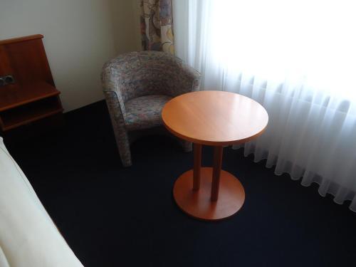 Ein Sitzbereich in der Unterkunft Centralhotel Ratingen