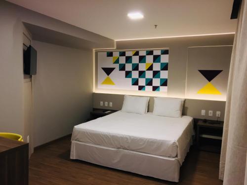 A bed or beds in a room at Master Express Cidade Baixa