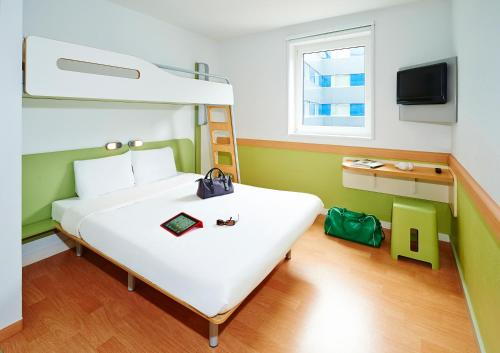 A bunk bed or bunk beds in a room at ibis budget Zurich City West