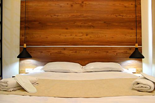 A bed or beds in a room at Apartment Kutaisi