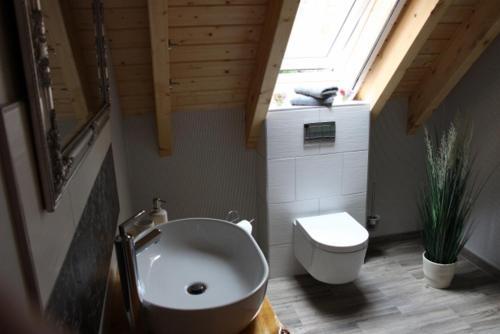 Ein Badezimmer in der Unterkunft Der Kolonist