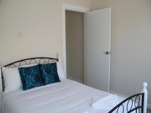 A bed or beds in a room at Beaches Serviced Apartments