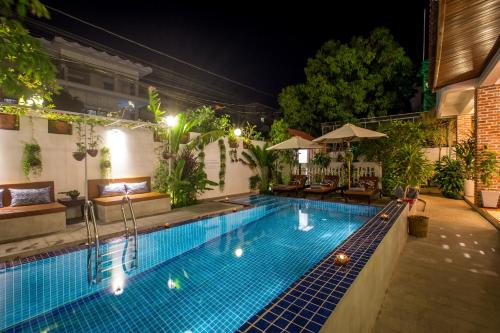 The swimming pool at or near VMANSION Boutique Hotel