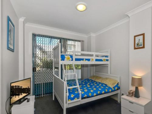 A bunk bed or bunk beds in a room at Ocean Palms 1