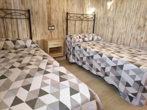 A bed or beds in a room at Casa rural La Franca