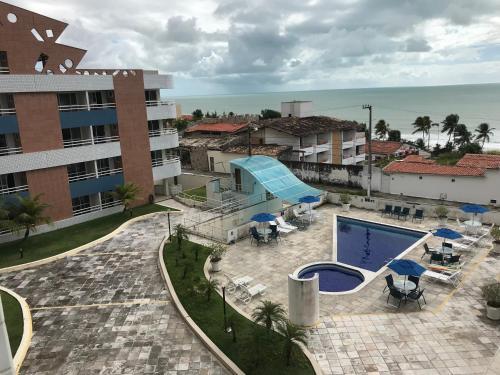 Uma vista da piscina em Terrazzo Ponta Negra Flat ou nos arredores