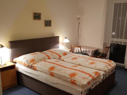 Postel nebo postele na pokoji v ubytování Apartmány v Podhájskej