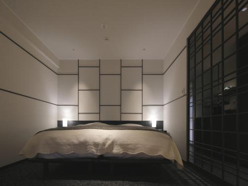 A bed or beds in a room at Azumaen