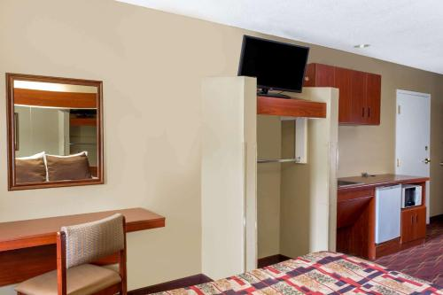 A television and/or entertainment center at Microtel Inn & Suites by Wyndham Norcross