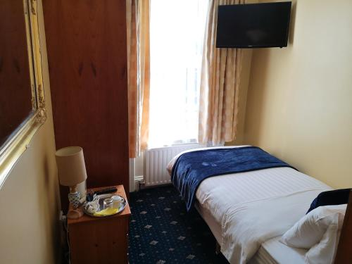 Кровать или кровати в номере ABC House Dublin