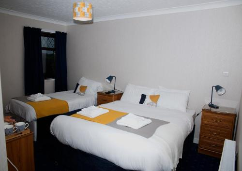 A bed or beds in a room at Herdshill Guest House