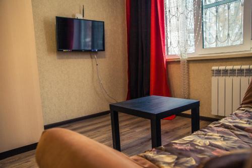 Телевизор и/или развлекательный центр в Апартаменты Городской Вал 14