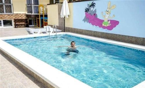 The swimming pool at or near Guest House Rodos