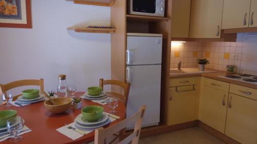 A kitchen or kitchenette at VVF Villages « Le Parc des Cévennes » Florac