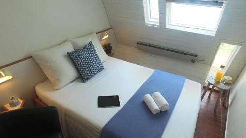 A bed or beds in a room at VVF Villages « La Plage des Grands Sables » Île-de-Groix