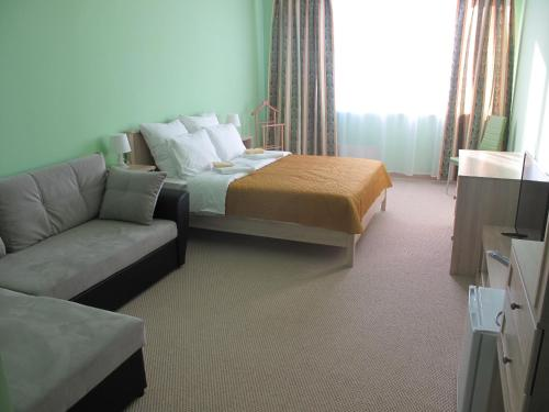 A bed or beds in a room at Bolshoy Ural na Stachek Hotel