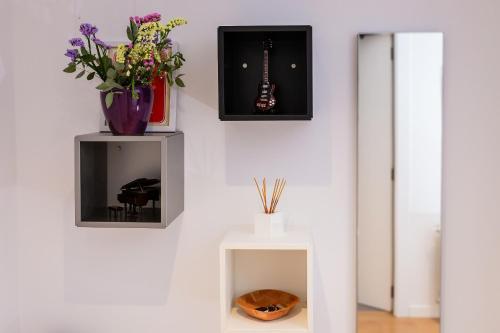 Una televisión o centro de entretenimiento en Apartamento Comedias