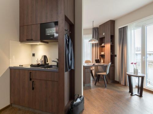 Küche/Küchenzeile in der Unterkunft Hotel Smartino