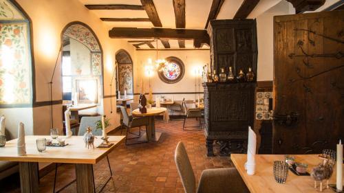 Ein Restaurant oder anderes Speiselokal in der Unterkunft Restaurant & ****Hotel HÖERHOF