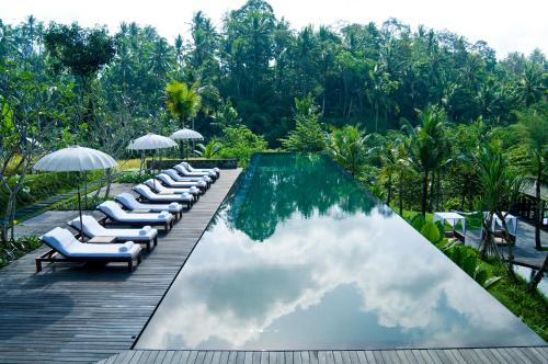 A view of the pool at Komaneka at Bisma Ubud or nearby
