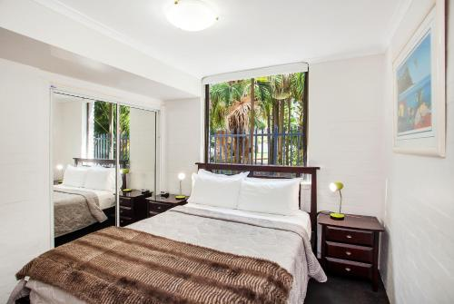 A bed or beds in a room at Noosa International Resort