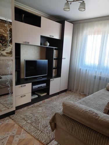 Телевизор и/или развлекательный центр в Апартаменты на Подгорной 49