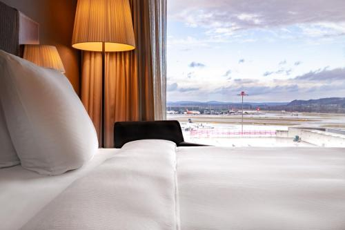 A bed or beds in a room at Radisson Blu Hotel Zurich Airport
