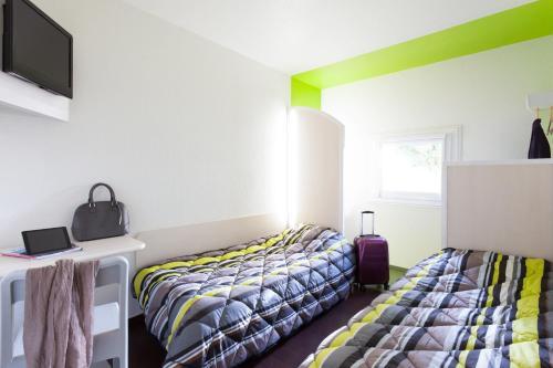Un ou plusieurs lits dans un hébergement de l'établissement hotelF1 Valenciennes Douchy les Mines