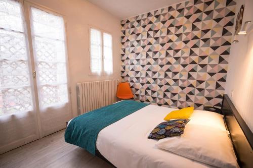 Un ou plusieurs lits dans un hébergement de l'établissement Hotel de Paris