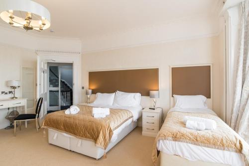 A bed or beds in a room at No 46 Marine Terrace