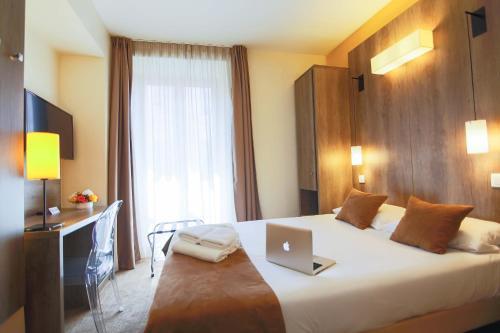 Un ou plusieurs lits dans un hébergement de l'établissement Hôtel Le Seize, Nice Centre