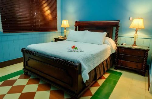 Cama o camas de una habitación en Hotel Victoriano