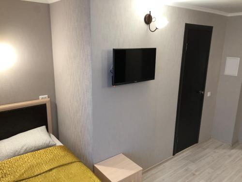 Телевизор и/или развлекательный центр в Аврора Центр Гостевые комнаты