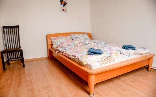 A bed or beds in a room at Tacskó Apartment