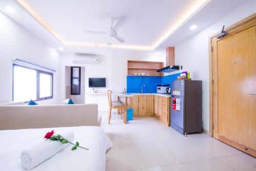 Кухня или мини-кухня в Sincero Hotel & Apartment