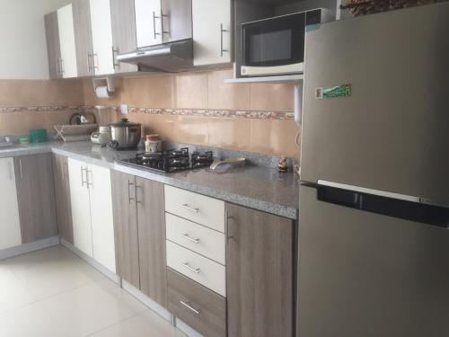 A kitchen or kitchenette at Departamentos Playa San Bartolo