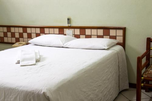 A bed or beds in a room at Hotel Metropolitano