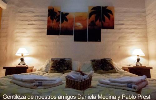 A bed or beds in a room at Villa El Refugio