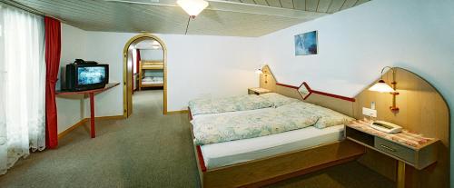 Ein Bett oder Betten in einem Zimmer der Unterkunft B&B Hotel Alpina
