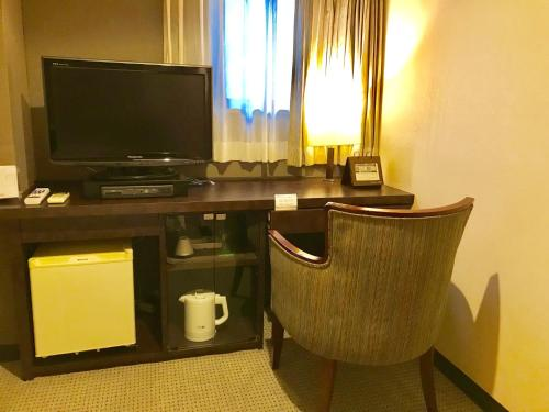A television and/or entertainment center at Sun Members Kobe
