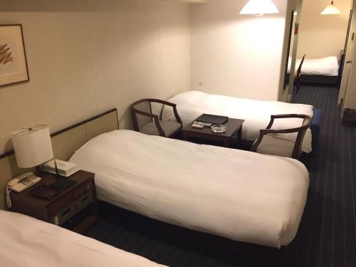 A bed or beds in a room at Sun Members Kobe