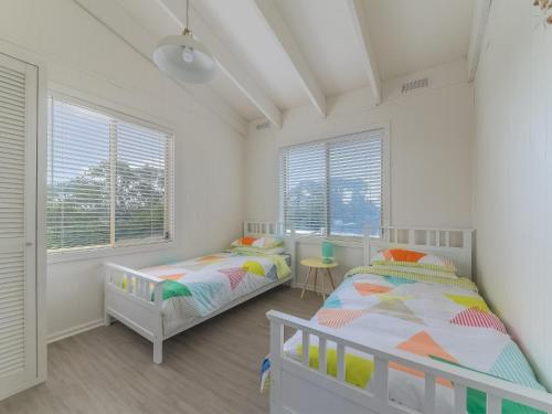 A bed or beds in a room at 63 Marlin Street, Smiths Beach