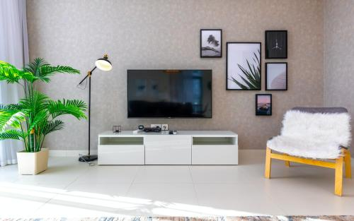 A television and/or entertainment centre at FAM Living - Mada Residences Downtown Dubai