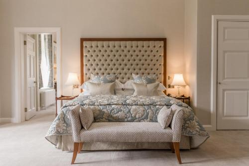 A bed or beds in a room at Tylney Hall Hotel