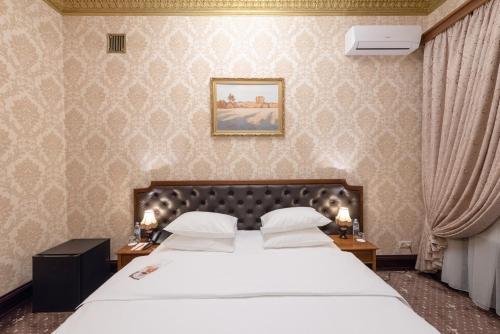 Кровать или кровати в номере Легендарный отель Советский