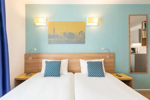 Un ou plusieurs lits dans un hébergement de l'établissement Aparthotel Adagio Access La Défense - Place Charras