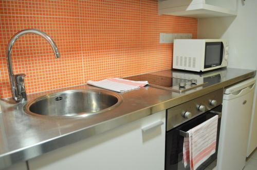 A kitchen or kitchenette at UC Hall Residence