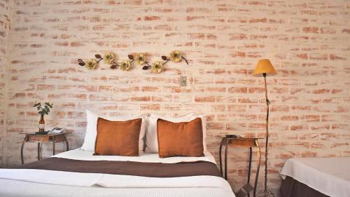 A bed or beds in a room at Pousada Cachoeiras da Furna