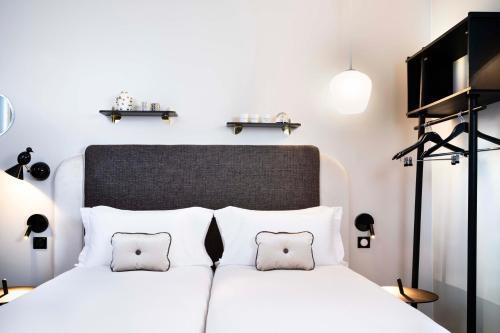 Cama o camas de una habitación en Hôtel Eiffel Saint Charles