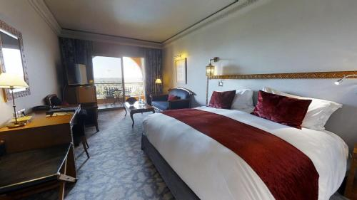 A bed or beds in a room at Sofitel Marrakech Palais Imperial